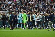 Bradford City goalkeeper Colin Doyle (1) (r) and Millwall goalkeeper Jordan Archer (1) greet each other after the game whilst Millwall fans invade the pitch after the EFL Sky Bet League 1 play off final match between Bradford City and Millwall at Wembley Stadium, London, England on 20 May 2017. Photo by Martin Cole.