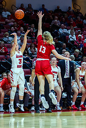 NORMAL, IL - February 07: Mary Crompton takes a 3 point shot from near the Redbird bench with her teammates cheering her on and guarded by Tatum Koenig during a college women's basketball game between the ISU Redbirds and the Braves of Bradley University February 07 2020 at Redbird Arena in Normal, IL. (Photo by Alan Look)