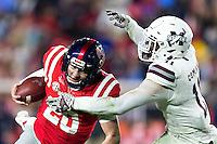 OXFORD, MS - NOVEMBER 26:  Shea Patterson #20 of the Mississippi Rebels runs the ball and is tackled by Kivon Coman #11 of the Mississippi State Bulldogs at Vaught-Hemingway Stadium on November 26, 2016 in Oxford, Mississippi.  The Bulldogs defeated the Rebels 55-20.  (Photo by Wesley Hitt/Getty Images) *** Local Caption *** Shea Patterson; Kivon Coman