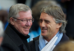 MANCHESTER, ENGLAND - Monday, April 30, 2012: Manchester City manager Roberto Mancini greets Manchester United manager Sir Alex Ferguson during the Premiership match at the City of Manchester Stadium. (Pic by Chris Brunskill/Propaganda)