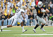 November 10 2012: Iowa Hawkeyes tight end C.J. Fiedorowicz (86) tries to stiff arm Purdue Boilermakers cornerback Ricardo Allen (21) after a catch during the NCAA football game between the Purdue Boilermakers and the Iowa Hawkeyes at Kinnick Stadium in Iowa City, Iowa on Saturday, November 10, 2012. Purdue defeated Iowa 27-24.