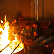With winter looming at a camp near Thessaloniki a group of Syrian Kurds, a mixture of friends and family who left their home 9 months ago, gather around a fire making tea as they wait for the next stages in their migration into Europe.
