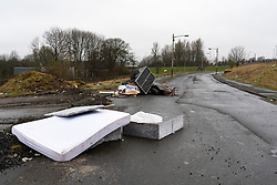 Fly tipping of household goods on street in Easterhouse in Glasgow, Scotland UK