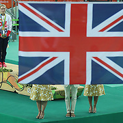 Track Cycling - Olympics: Day 11  Laura Trott of Great Britain watches the Union Jack flag raised after receiving her gold medal for winning the Women's Omnium Points Race during the track cycling competition at the Rio Olympic Velodrome August 16, 2016 in Rio de Janeiro, Brazil. (Photo by Tim Clayton/Corbis via Getty Images)