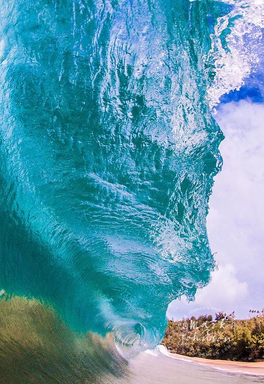 Powerful wave breaking off of a Hawaiian beach