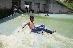 May 5, 2017 - Dhaka, BAngladesh - On the hot summer noon, Bangladeshi children play and bathe in the polluted water of a lake in Dhaka, Bangladesh. The temperature in Dhaka reached 39 degrees Celsius. (Credit Image: © Suvra Kanti Das via ZUMA Wire)