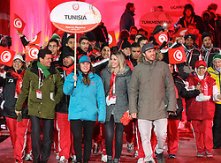18.03.2017, Planai-Stadion, Schladming, AUT, Special Olympics 2017, Wintergames, Eröffnungsfeier, im Bild der Einmarsch der Delegation aus Tunesien mit den Skirennläufern Cornelia Hütter (AUT) und Christian Walder (AUT) // the delegation of Tunisia with the ski racers Cornelia Hütter of Austria and Christian Walder of Austria during the opening ceremony in the Planai Stadium at the Special Olympics World Winter Games Austria 2017 in Schladming, Austria on 2017/03/17. EXPA Pictures © 2017, PhotoCredit: EXPA / Martin Huber