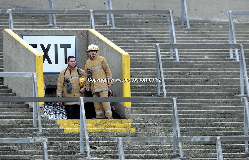 Fire Fighters assess the stands during the All Blacks versus Ireland Rugby Union match at Lansdowne Road, Dublin, Saturday 12 November 2005.The All Blacks won the match 45-7. Photo: Andrew Cornaga/PHOTOSPORT<br />