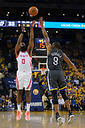 April 30, 2019; Oakland, CA, USA; Houston Rockets guard James Harden (13) shoots the basketball against Golden State Warriors guard Andre Iguodala (9) during the second quarter in game two of the second round of the 2019 NBA Playoffs at Oracle Arena.