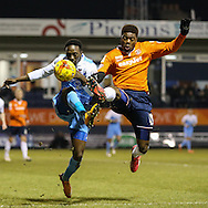 Nathan Oduwa of Luton Town, currently on loan from Tottenham Hotspur, (right) and Marvin McCoy of York City (left) challenge for the ball during the Sky Bet League 2 match at Kenilworth Road, Luton<br /> Picture by David Horn/Focus Images Ltd +44 7545 970036<br /> 10/02/2015