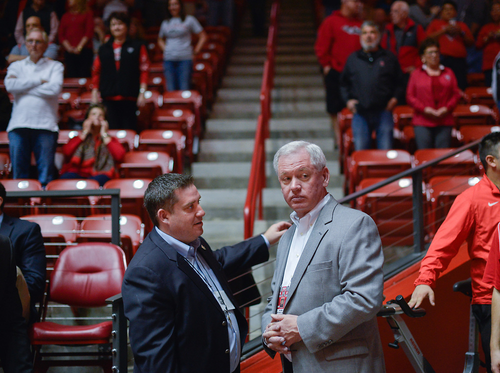 02.27.2016    <br /> Vice-President for Athletics Paul Krebs (cq),right, and Deputy Athletic Director for External Operations Brad Hutchins (cq) converse before the start of the game against  Fresno State Saturday evening at the Pit. Albuquerque, New Mexico.   Roberto E. Rosales/Journal