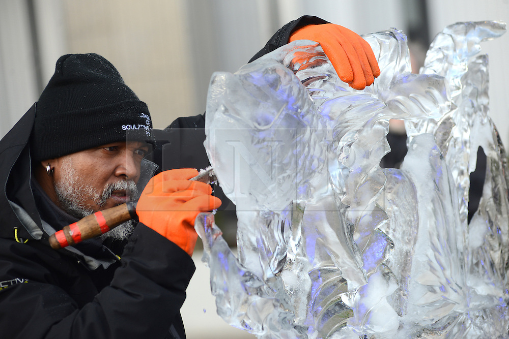© Licensed to London News Pictures.10/01/2013. London, UK. A member of team Africa creates an ice sculpture during the single block ice-sculpting competition at the London Ice Sculpting Festival in Canary Wharf.. Photo credit : Peter Kollanyi/LNP