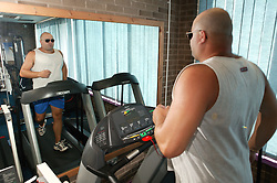 Access to services, Disabled man in the gym; using treadmill,