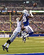 Sep 8, 2013; Indianapolis, IN, USA; Indianapolis Colts cornerback Greg Toler (28) intercepts a pass intended for Oakland Raiders wide receiver Rod Streater (80) at Lucas Oil Stadium. Mandatory Credit: Pat Lovell-USA TODAY Sports