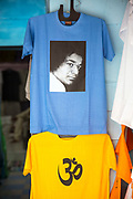 PUTTARPATHI, INDIA - 27th October 2019 - T-shirts with prints of the 'Om' symbol and a photo of the late Sathya Sai Baba for sale in the Puttarpathi markets, Andhra Pradesh, South India