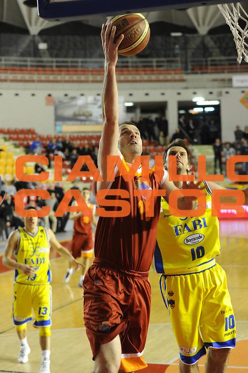 DESCRIZIONE : Roma Lega A 2011-2012 Acea Roma Fabi Shoes Montegranaro<br /> GIOCATORE : Michalis Kakiouzis<br /> CATEGORIA : tiro <br /> SQUADRA : Acea Roma<br /> EVENTO : Campionato Lega A 2011-2012<br /> GARA : Acea Roma Fabi Shoes Montegranaro<br /> DATA : 08/02/2012<br /> SPORT : Pallacanestro<br /> AUTORE : Agenzia Ciamillo-Castoria/GiulioCiamillo<br /> GALLERIA : Lega Basket A 2011-2012<br /> FOTONOTIZIA : Roma Lega A 2011-2012 Acea Roma Fabi Shoes Montegranaro<br /> PREDEFINITA :