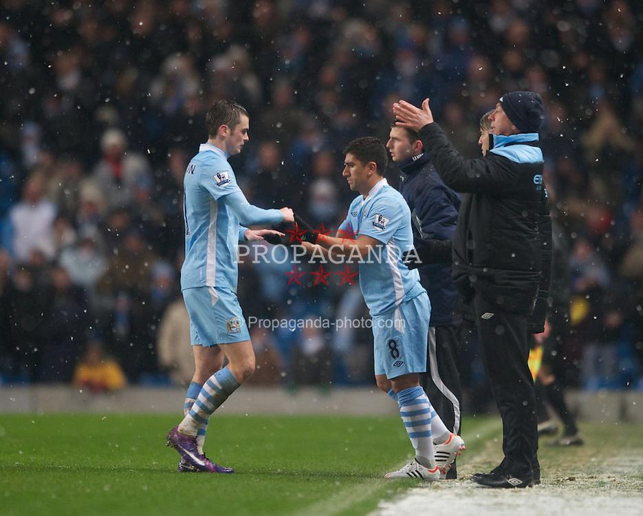 LONDON, ENGLAND - Sunday, February 04, 2012: Manchester City's David Pizarro replaces team-mate Adam Johnson during the Premiership match at the Etihad Stadium. (Pic by Chris Brunskill/Propaganda)
