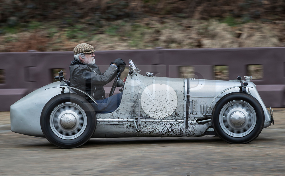 © Licensed to London News Pictures. 28/01/2018. Weybridge, UK. Competitor Stuart Ulph drives a 1928/30 Austin Ulster Special at Brooklands Museum as he takes part in The Vintage Sports-Car Club's New Year driving tests round the historic motor racing circuit. Photo credit: Peter Macdiarmid/LNP
