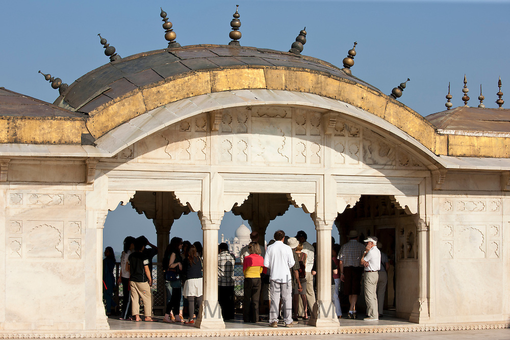 Taj Mahal from Khas Mahal Palace built 17th Century by Mughal Shah Jehan for his daughters at Agra Fort, India