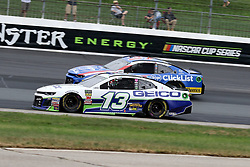 July 22, 2018 - Loudon, NH, U.S. - LOUDON, NH - JULY 22: (13) Ty Dillon and (37) Chris Buescher in turn 3 during the Monster Energy Cup Series Foxwoods Resort Casino 301 race on July, 21, 2018, at New Hampshire Motor Speedway in Loudon, NH. (Photo by Malcolm Hope/Icon Sportswire) (Credit Image: © Malcolm Hope/Icon SMI via ZUMA Press)