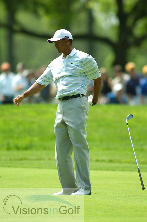 Tiger Woods drops his club in frustration and mad on his way to missing the cut at the USGA Open Championship 2006, Winged Foot, NY, USA.<br />Photo Credit: visionsingolf.com  / Bob Strauss / US Open Championship 2006 USGA USA.
