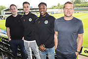 Forest Green Rovers head of recruitment Richard Hughes, Aaron Collins, Ebou Adams and Forest Green Rovers manager, Mark Cooper signs a contract ahead of the 2019/20 season with Forest Green Rovers at the New Lawn, Forest Green, United Kingdom on 18 June 2019.
