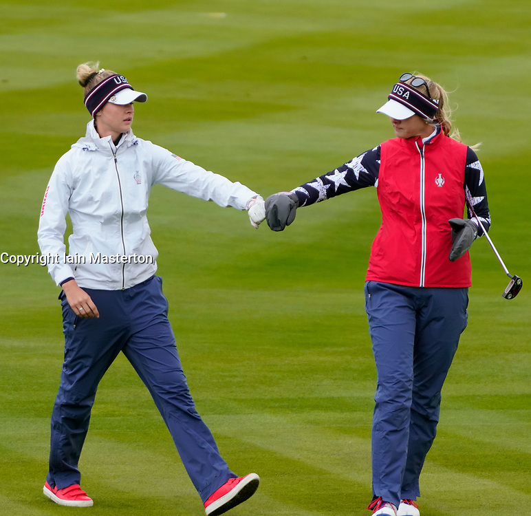 Auchterarder, Scotland, UK. 14 September 2019. Saturday morning Foresomes matches  at 2019 Solheim Cup on Centenary Course at Gleneagles. Pictured;  Nelly Korda (l) and Jessica Korda of Team USA fist pump after good approach shot to 2nd green.  Iain Masterton/Alamy Live News