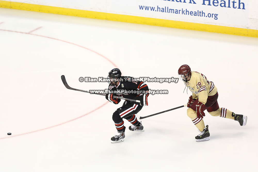 Torin Snyderman #17 of the Northeastern Huskies and Scott Savage #28 of the Boston College Eagles skate to the puck during The Beanpot Championship Game at TD Garden on February 10, 2014 in Boston, Massachusetts. (Photo by Elan Kawesch)
