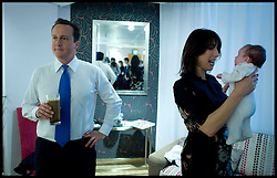 The Prime Minister David Cameron in the Green room with his wife Samantha and his baby daughter florence, after giving his speech to the Conservative Party Conference in Birmingham, UK, Wednesday October 6,  2010. Photo By Andrew Parsons / i-Images.