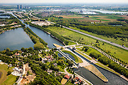 Nederland, Limburg, Gemeente Maasgouw, 27-05-2013; sluis Panheel, kanaal Wessem-Nederweert. Maasbracht en Prins Clauscentrla ein de achtergrond.<br /> De sluis is voorzien van spaarbekkens (om bij het schutten water te besparen bij lage waterstanden van de Maas).<br /> Shipping lock Panheel, canal Wessem-Nederweert. The lock is equipped with reservoirs to save water at low water levels of the river Meuse.<br /> luchtfoto (toeslag op standaardtarieven);<br /> aerial photo (additional fee required);<br /> copyright foto/photo Siebe Swart.