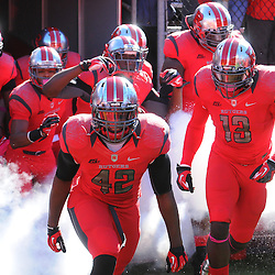 Oct 13, 2012: Rutgers Scarlet Knights linebacker Steve Beauharnais (42) leads his team onto the field for NCAA Big East college football action between the Rutgers Scarlet Knights and Syracuse Orange at High Point Solutions Stadium in Piscataway, N.J.