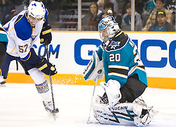 January 6, 2010; San Jose, CA, USA; San Jose Sharks goalie Evgeni Nabokov (20) blocks a shot from St. Louis Blues left wing David Perron (57) during the first period at HP Pavilion. San Jose defeated St. Louis 2-1 in overtime. San Jose defeated St. Louis 2-1 in overtime. Mandatory Credit: Jason O. Watson / US PRESSWIRE