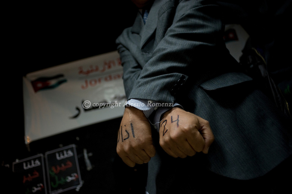 JORDAN, Amman : A supporter of the March 24 group is seen during a press conference in Amman on March 26, 2011 as Jordan's Islamist opposition, leftists and trade unions on Saturday demanded the ouster of Prime Minister Maaruf Bakhit, blaming him for violence that has killed one person and injured 130.ALESSIO ROMENZI