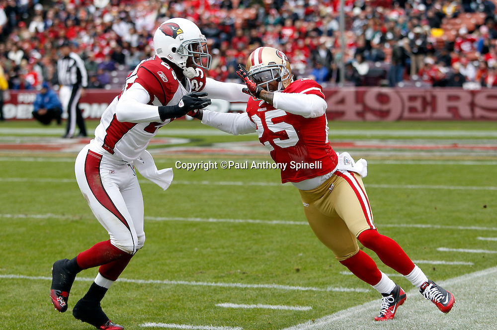 San Francisco 49ers cornerback Tarell Brown (25) gets shoved out of bounds by Arizona Cardinals cornerback Dominique Rodgers-Cromartie (29) on special teams kick coverage during the NFL week 17 football game against the Arizona Cardinals on Sunday, January 2, 2011 in San Francisco, California. The 49ers won the game 38-7. (©Paul Anthony Spinelli)