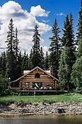 Log cabin home on the banks of the Chena River, Fairbanks, Alaska, USA