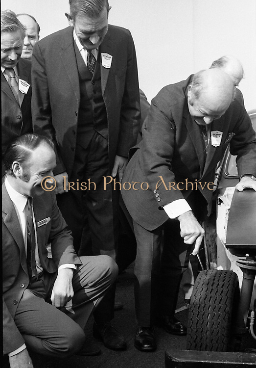 Dunlop Total Mobility Tyre At Mondello Park..1972..13.10.1972.10.13.1972..13th October 1972..A revolutionary new tyre development which can end the hazardous effects of a blowouts and punctures was announced by Dunlop.The T4 Total Mobility Tyre is designed to allow the motorist to continue for a distance of up to 100 miles at speeds of 50mph even if the tyre is deflated. The tyre is designed to enable the driver maintain control of the vehicle in the event of a blowout...Image of Mr P J McGowan,Chief engineer,Dept of Local Government and Mr John Sheridan,Director,Irish Dunlop Ltd watch Mr Tommy Hogan taking control as he punctures the prototype tyre on the test vehicle.
