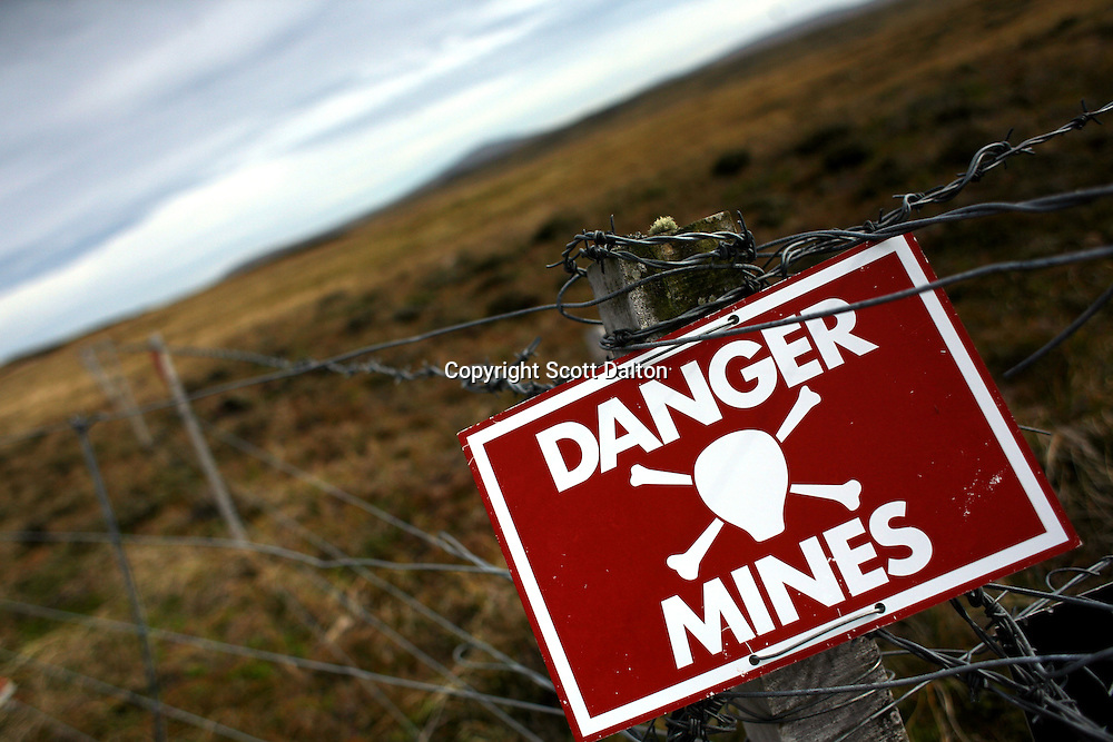 A sign warns of land mines just outside of Stanley, the capital of the Falkland Islands, on Sunday, March 18, 2007. Thousands of mines were placed all over the Falkland Islands by the Argentinean forces to try to deter any British invasion to retake the islands. Most of the mines have not been removed. (Photo/Scott Dalton)