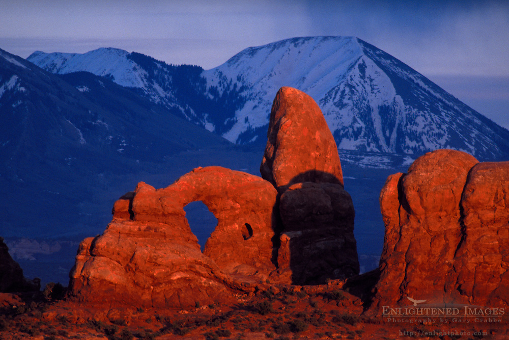 Sunset light on Turret Arch and the LaSal Mountains during a storm as seen from Arches National Park, UTAH