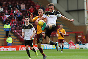 Andrew Considine challenges Louis Moult during the Ladbrokes Scottish Premiership match between Motherwell and Aberdeen at Fir Park, Motherwell, Scotland on 15 August 2015. Photo by Craig McAllister.