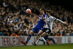 Andy King of Leicester City chips the ball under pressure from Tommy Carroll of Tottenham Hotspur - Mandatory byline: Jason Brown/JMP - 07966386802 - 10/01/2016 - FOOTBALL - White Hart Lane - London, England - Tottenham v Leicester City - The Emirates FA Cup