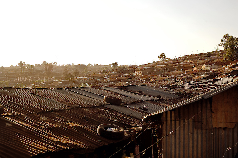 The name 'Kibera' is a Nubian word for 'forest'. Kibera is roughly 2 Kilometres squared with an estimated population of 1 million people. There are no residential buildings over a single storey. The average home size in Kibera is 3 meters, with an average of five persons per dwelling.