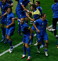 Photo: Glyn Thomas.<br />Italy v France. FIFA World Cup 2006 Final. 09/07/2006.<br /> Italy's Fabio Grosso (C) leads the celebrations.