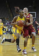 December 09 2010: Iowa guard Kachine Alexander (21) drives past Iowa St. guard Kelsey Bolte (11) during the first half of their NCAA basketball game at Carver-Hawkeye Arena in Iowa City, Iowa on December 9, 2010. Iowa defeated Iowa State 62-40 in the Hy-Vee Cy-Hawk Series rivalry game.