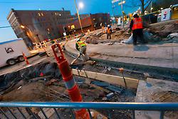 Kansas CIty streetcar line construction work underway at Third & Delaware Streets, River Market area of downtown Kansas City, Missouri at dusk.