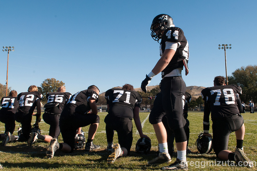 Trace Cummings and teammates (L to R: Aaron Friend, Josh Duckworth, Karson Brown, Lane Hicks, Wyatt Currey, Trace Cummings, Cody Ross) before the start of the Vale - Cascade Christian 3A quarterfinal playoff game at Frank Hawley Stadium, Vale, Oregon, Saturday, November 14, 2015. Vale won 48-38.