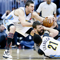 01 February 2016: Memphis Grizzlies center Marc Gasol (33) vies for the rebound with Denver Nuggets forward Danilo Gallinari (8) and Denver Nuggets forward Wilson Chandler (21) during the Memphis Grizzlies 119-99 victory over the Denver Nuggets, at the Pepsi Center, Denver, Colorado, USA.
