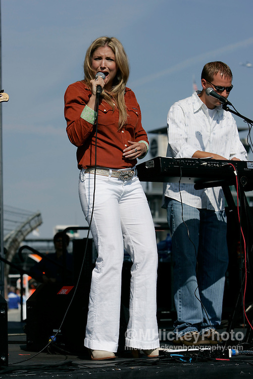 Country music recording artist Julie Roberts performs at the Indianapolis Motor Speedway prior to the Brickyard 400 Photo by Michael Hickey