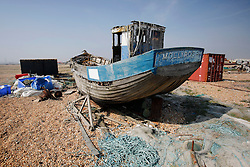 UK ENGLAND DUNGENESS 24MAR12 - Discarded fishing boats, containers and fishing gear at Dungeness shingle beach on the Kent coast. It is the  largest area of open shingle in Europe, measuring 12 km by 6 km, which has been deposited by the sea and built up over thousands of years.....jre/Photo by Jiri Rezac....© Jiri Rezac 2012