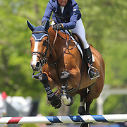 Charles Jacobs riding Cassinja S in action during the $100,000 Empire State Grand Prix presented by the Kincade Group during the Old Salem Farm Spring Horse Show, North Salem, New York,  USA. 17th May 2015. Photo Tim Clayton