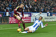 Huddersfield Town defender Chris Lowe (15) does sliding tackle on Freddie Sears (20) Ipswich Town  during the EFL Sky Bet Championship match between Huddersfield Town and Ipswich Town at the John Smiths Stadium, Huddersfield, England on 21 January 2017. Photo by Ian Lyall.
